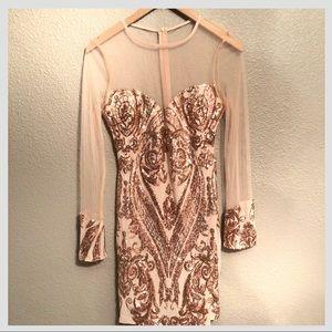 Sequins mesh dress.
